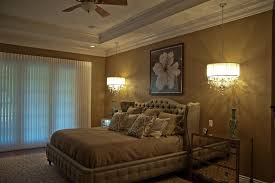 table lamps are the old stand by for bedside table lighting hang a mini chandelier over your bedside table for an unexpected and dramatic look