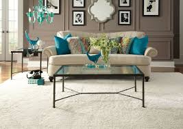 yellow area rugs with contemporary living room and large area rug black frames teal pillows beige pillow black and white frames
