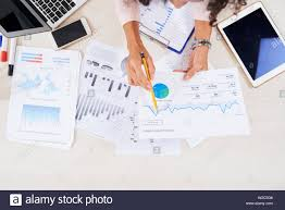 Hands Of Female Financial Manager Analyzing Various Charts