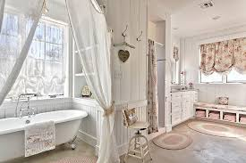 View in gallery Comfy shabby chic bathroom in white with claw-foot bathtub  [Design: Schmidt Custom