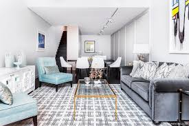 turquoise walls living room blue chairs gray sofa geometric rug dining