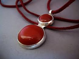 this handmade wire wrapped natural stone cabochon pendant is made with a red brecciated jasper from red river africa the color is more brick red and