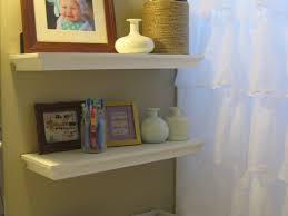 bathroom floating shelves above toilet