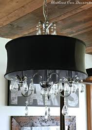 gorgeous and affordable black drum chandelier perfect for a bedroom light makeover here
