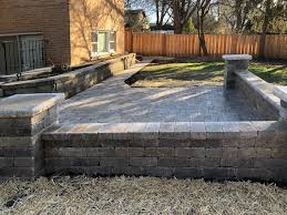 brick paver patio seat wall and pillars using brussels block and brussels dimensional stone by unilock paver patio pillars and seat wall arlington heights