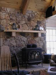 wood stove with mantle and stone surround working with what I have