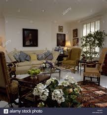 Townhouse Living Room Cream Knole Sofa In Townhouse Living Room With White Hydrangeas On