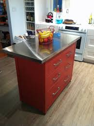 A small, but nice looking center island. Another Ikea hack, all you need is  a Expedit Bookcase, Vika Hyttan Stainless Steel countertop, and Vika By