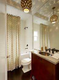 ceiling track shower curtain patterned curtain chains white tile black shower head chandelier big mirror black