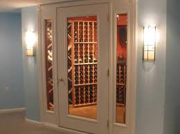 a vint white painted full glass wine cellar door entrance with two 15 inch sidelights