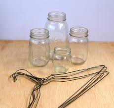 Coat hangers and mason jars turned rustic hanging