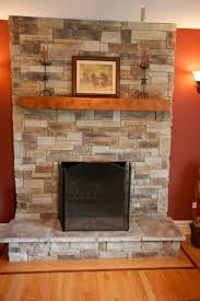 ledge stone fireplace stone veneer applied directly over brick and a spruce beam mantel