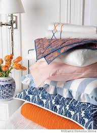 williams sonoma s everyday luxury bedding line features the colors of blue and orange in crisp