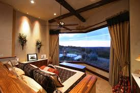 belvedere lake travis master bedroom with hill country views by zbranek holt custom homes austin and lake travis custom home builders