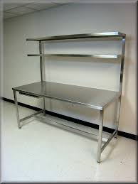 stainless steel table with double upper shelves and sliding keyboard tray
