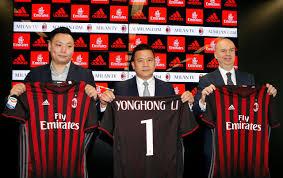 ac milan. david han li (l), yonghong (c) and marco fassone show a ac milan jersey during news conference in milan, italy, april 14, 2017. ac