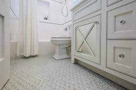 gray bathroom with blue and gray geometric glass tile floor