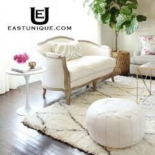 east unique adds new collection of vintage and new moroccan berber rugs and an expanded range of moroccan pouffes