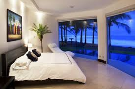 beach design bedroom. Beach Themed Bedrooms With White Floor Tiles And Wall Combined Dark Brown Wooden Bed Furniture Also Set Design Bedroom