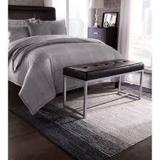 modern bedroom design with walmart area rugs and dark hardwood floor and  cozy tufted bed