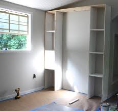 Built In Wall Shelves Create Built In Shelving And Cabinets On A Tight Budget