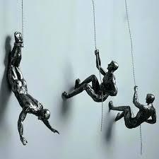 metal climbing man wall sculpture uk