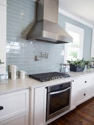 Kitchen, Detail Other key features in the new kitchen are stainless steel  appliances, vent hood and a subway tile backsplash in muted blue  a  favorite ...
