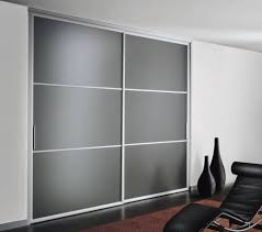 furniture sliding door wardrobe with frosted glass and silver metal frame together white wall paint