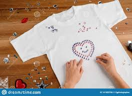 Design Your Own Bedazzled T Shirt Girl Laying Out Rhinestones Stock Photo Image Of Diamond