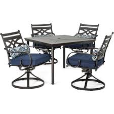 hanover montclair 5 piece metal outdoor dining set with navy blue cushions swivel rockers