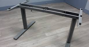 with the table lift assembled you ll now want to flip it over and place it on the underside of the desk please keep in mind the minimum dimensions required