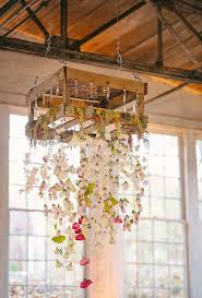 to soften the look of an otherwise industrial wedding space a trailing fl chandelier