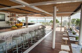 malibu farm miami beach restaurant entrance bar and dining tables with the ocean view preview