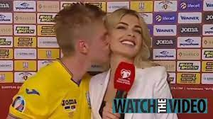 Watch Zinchenko kiss stunning reporter on live TV as Man City ace confirms  rumours he's dating Vlada Sedan