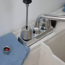 removing the set that holds the faucet handle in place