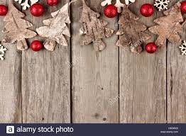 Rustic Christmas top border with wood ornaments and red baubles on ...