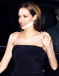 angelina jolie suffers a white powdered makeup malfunction while attending a screening for hbo s the