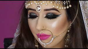 real bride nikaah asian bridal makeup bold eyes and bright pink lips arabic makeup
