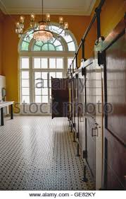 large public bathroom. vintage interior with chandelier \u0026 tiled floor of large public bathroom at the historical chattanooga choo c