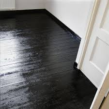 Painted black floors Simple and fresh fix to damaged wood floors when  sanding and staining are not an option.