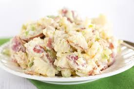 a plate of potato salad made with red skinned potatoes