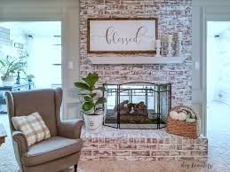 painting a fireplace to brighten up a room diybeautify com