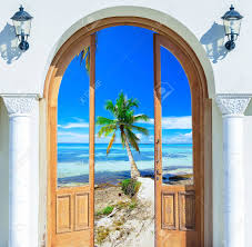 open door with access to the beach view of palms stock photo 65285651