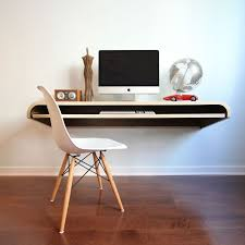 dario antonioni of design lab conceived of the float wall desk as a perfect space saving work area for the modern home office it s simple design lends