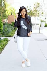 white jeans the home t black leather jacket white sneakers