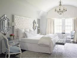 tall headboards - button tufted white king size headboard - Katie by Design  via Atticmag