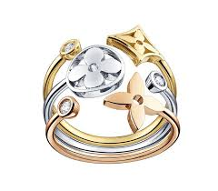 louis vuitton jewelry. this stackable louis vuitton ring in white, yellow and pink gold with diamonds from the jewelry n