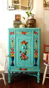 painted furniture ideasPretty Navy Blue With Pink Flower Motif On Small Cabinet Above