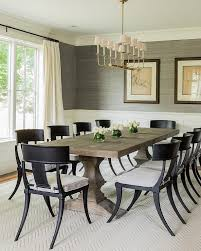 transitional dining room features upper walls clad in gray grcloth and lower walls clad in wainscoting alongside a restoration hardware dumont