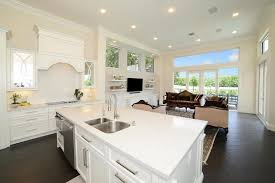 open layout kitchen with white cabinets and super white quartz counter